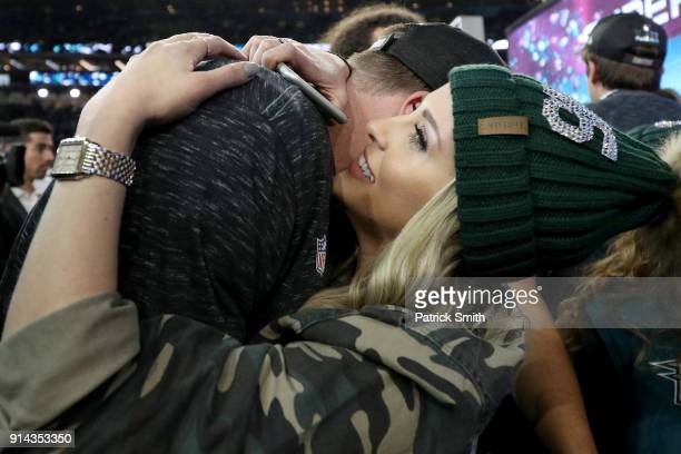 Rick Lovato of the Philadelphia Eagles celebrates with girlfriend Jordan Britt after defeating the New England Patriots 4133 in Super Bowl LII at US...