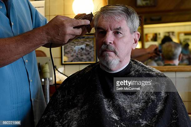 Rick Lozano cuts Matt Deans' hair at Sam Hill's Barber Shop in Englewood Colorado on August 18 2016 Sam Hill's Barber Shop is the longest...