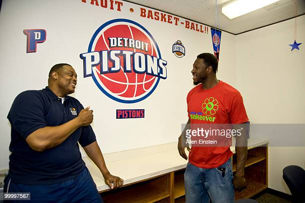 Rick Mahorn, NBA Legend and Ben Wallace, of the Detroit Pistons, share a laugh after installing the Piston logo during the Leadership Detroit...