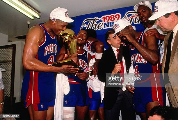 Rick Mahorn of the Detroit Pistons celebrates with his teamates in the locker room after winning the 1989 NBA Finals against the Los Angeles Lakers...