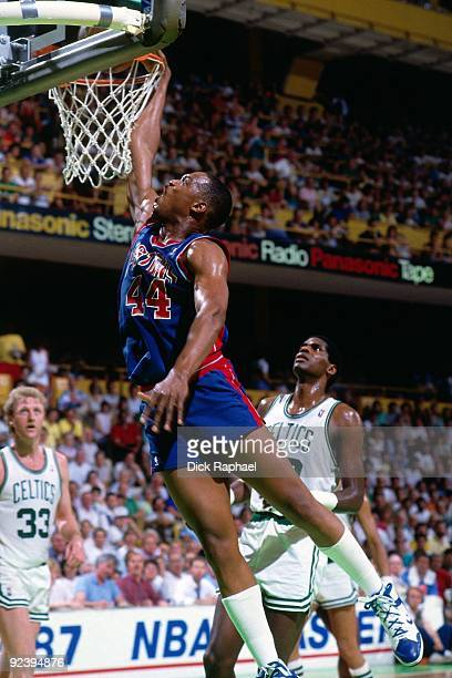 Rick Mahorn of the Detroit Pistons dunks against the Boston Celtics during a game played in 1987 at the Boston Garden in Boston Massachusetts NOTE TO...