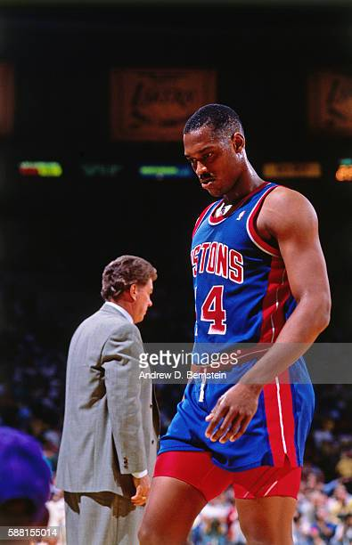 Rick Mahorn of the Detroit Pistons looks on against the Los Angeles Lakers during Game 6 of the 1988 NBA Finals at The Forum in Los Angeles,...
