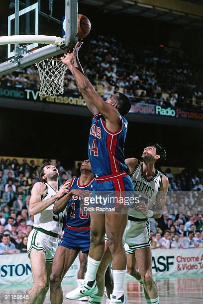 Rick Mahorn of the Detroit Pistons shoots a layup against Kevin McHale of the Boston Celtics during a game played in 1987 at the Boston Garden in...