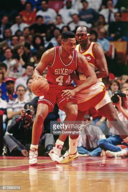 Rick Mahorn of the Philadelphia 76ers posts up against the Atlanta Hawks during a game played circa 1990 at the Omni in Atlanta Georgia NOTE TO USER...