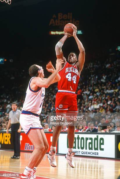 Rick Mahorn of the Philadelphia 76ers shoots over Doug Roth of the Washington Bullets during an NBA basketball game circa 1990 at the Capital Centre...