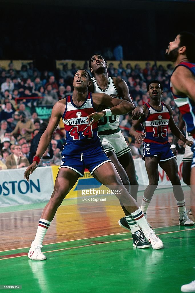 Rick Mahorn #44 of the Washington Bullets boxes out against Robert Parish #00 of the Boston Celtics during a game played in 1983 at the Boston Garden in Boston, Massachusetts.