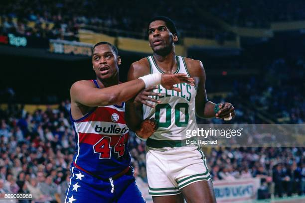 Rick Mahorn of the Washington Bullets defends against Robert Parish of the Boston Celtics circa 1985 at the Boston Garden in Boston Massachusetts...