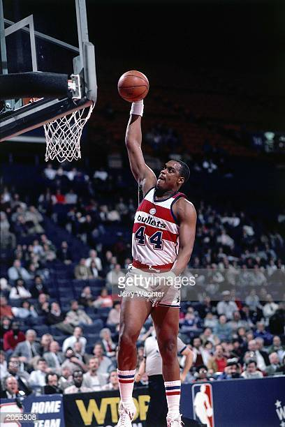 Rick Mahorn of the Washington Bullets dunks during the 1984 season NBA game at the USAir Arena in Washington DC NOTE TO USER User expressly...