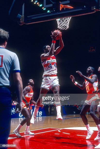 Rick Mahorn of the Washington Bullets grabs a rebound against the Atlanta Hawks during an NBA basketball game circa 1982 at the Capital Centre in...