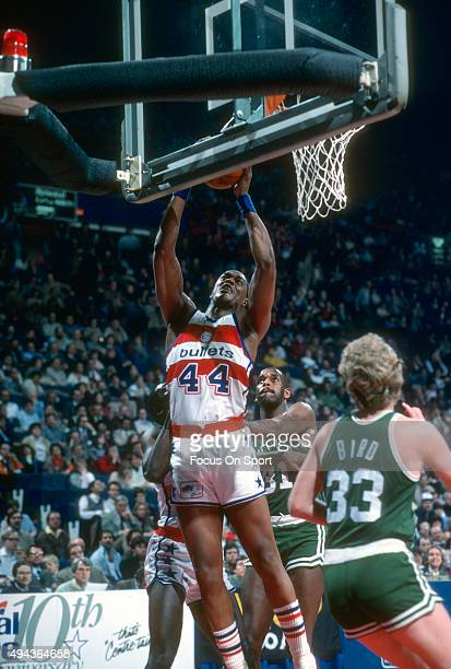 Rick Mahorn of the Washington Bullets grabs a rebound against the Boston Celtics during an NBA basketball game circa 1983 at the Capital Centre in...