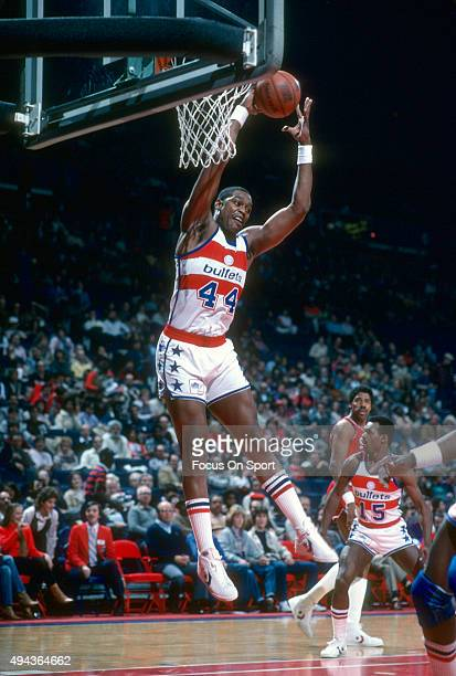 Rick Mahorn of the Washington Bullets grabs a rebound against the Philadelphia 76ers during an NBA basketball game circa 1983 at the Capital Centre...
