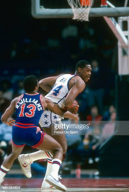 Rick Mahorn of the Washington Bullets looks to put a move on Ray Williams of the New Jersey Nets during an NBA basketball game circa 1982 at the...