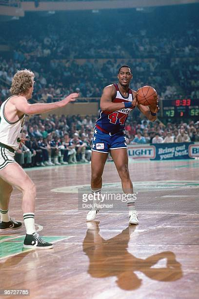 Rick Mahorn of the Washington Bullets passes against Larry Bird of the Boston Celtics during a game played in 1984 at the Boston Garden in Boston...