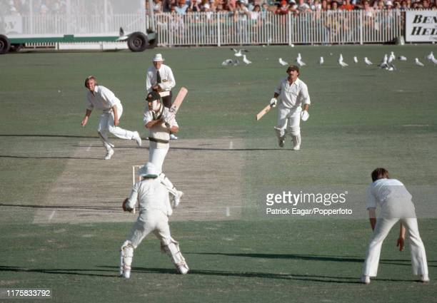Rick McCosker of Australia batting with a broken jaw pulls a delivery from England bowler John Lever during the Centenary Test match between...