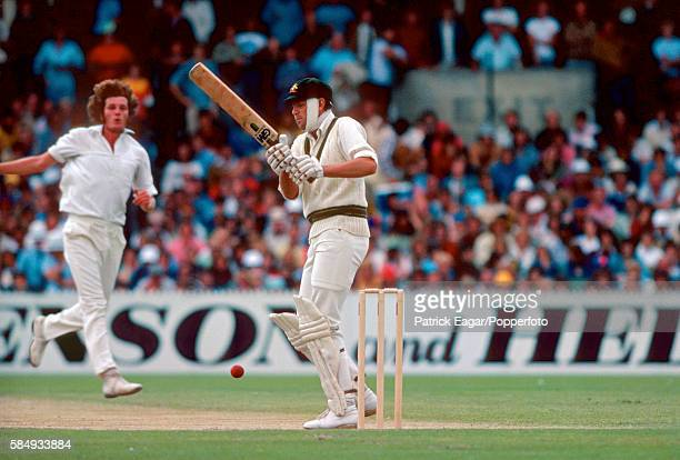 Rick McCosker of Australia batting with the bandaged broken jaw which he suffered in the first innings faces Bob Willis of England in the second...