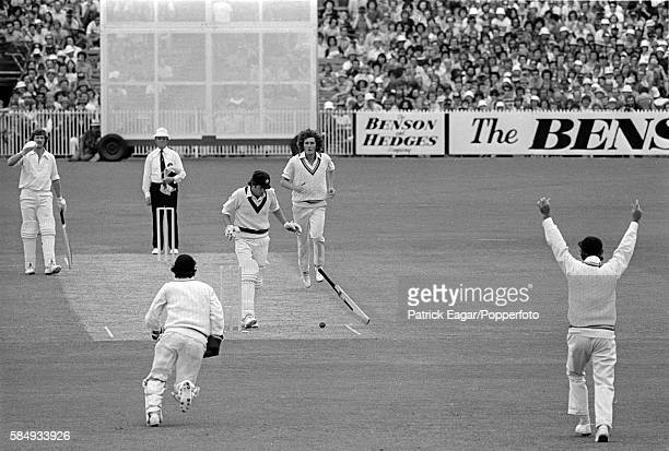Rick McCosker of Australia is hit on the jaw by a ball from Bob Willis of England and his jaw is broken in the first innings of the Centenary Test...