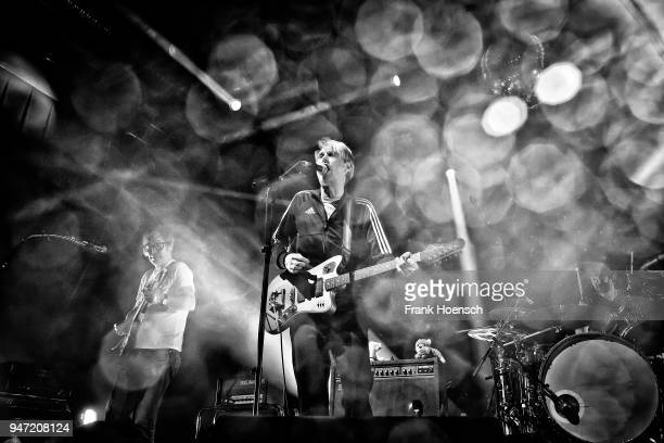 Rick McPhail Dirk von Lowtzow and Arne Zank of the German band Tocotronic perform live on stage during a concert at the Columbiahalle on April 16...