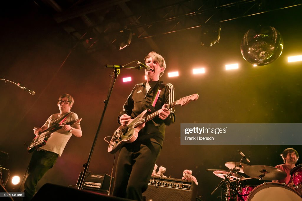 Rick McPhail, Dirk von Lowtzow and Arne Zank of the German band Tocotronic perform live on stage during a concert at the Columbiahalle on April 16, 2018 in Berlin, Germany.
