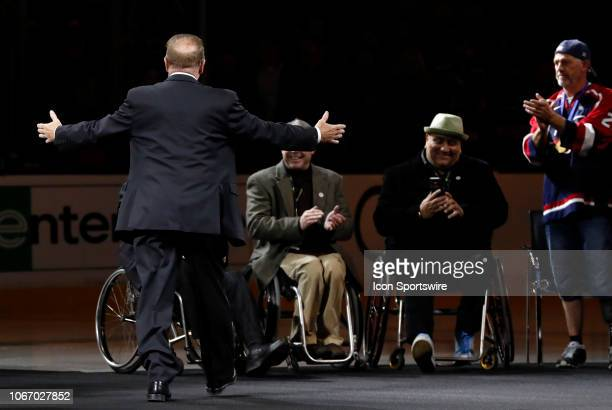 Rick Middleton reacts to seeing the men he guided to a gold medal in the 2002 Paralympic sled hockey tournament before a game between the Boston...