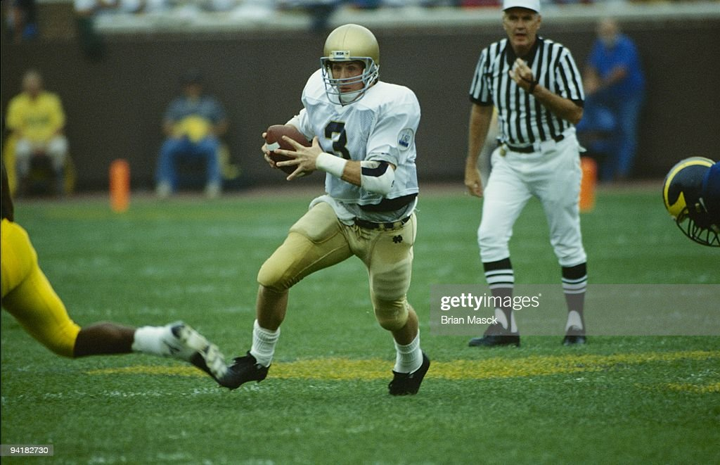 Rick Mirer #3 of the Notre Dame Fighting Irish runs with the ball during the game against the Michigan Wolverines at Michigan Stadium on September 14, 1991 in Ann Arbor, Michigan.