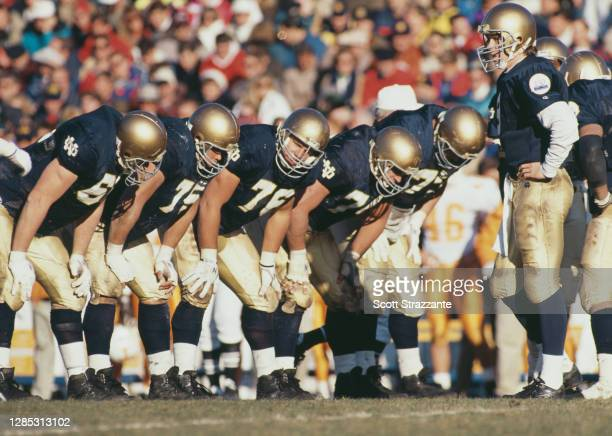 Rick Mirer, Quarterback for the University of Notre Dame Fighting Irish stands with his offensive line during the NCAA Southeastern Conference...