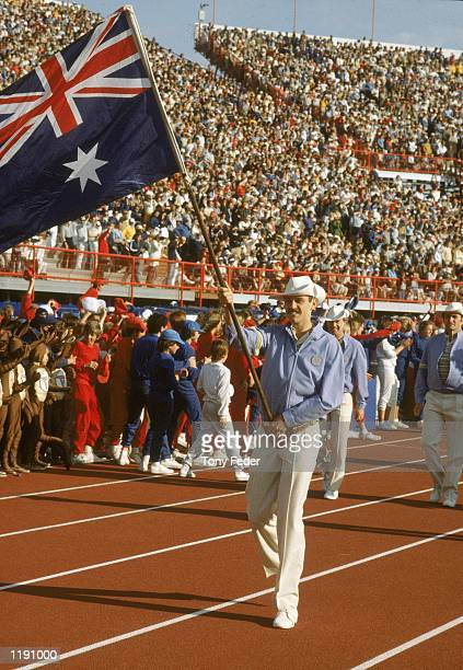 Rick Mitchell of Australia holds the national flag in the opening ceremony during the Commonwealth Games held in Brisbane Australia Mandatory Credit...