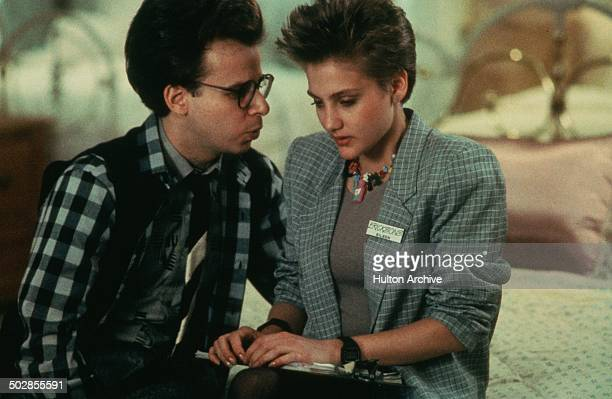 Rick Moranis gets closer to Jenny Wright n a scene for the Universal Studios movie The Wild Life circa 1984