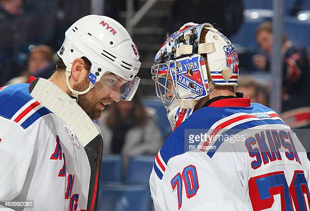 Rick Nash and Mackenzie Skapski of the New York Rangers celebrate their 31 win against the Buffalo Sabres on February 20 2015 at the First Niagara...