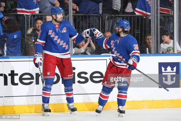 Rick Nash and Mats Zuccarello of the New York Rangers celebrate after scoring a goal in the first period against the Edmonton Oilers at Madison...