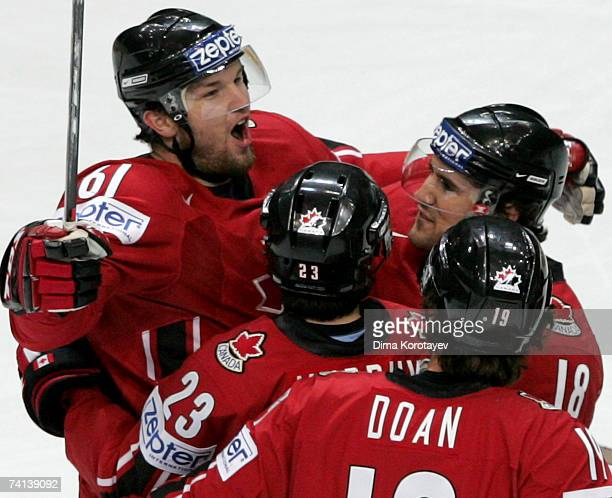 Rick Nash jubilates with his Canada teammates after scoring against team Finland during the IIHF World Ice Hockey Championship final match between...