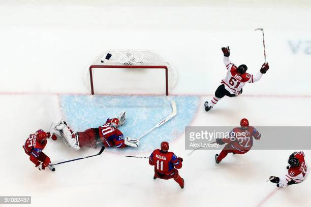 Rick Nash of Canada celebrates with his team after scoring past Evgeny Nabokov of Russia during the ice hockey men's quarter final game between...