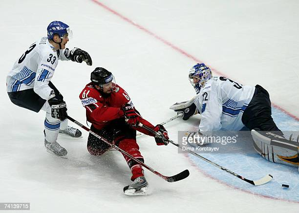 Rick Nash of Canada fights for the puck with Kari Lehtonen and Pekka Saravo during of Finland the IIHF World Ice Hockey Championship final match...