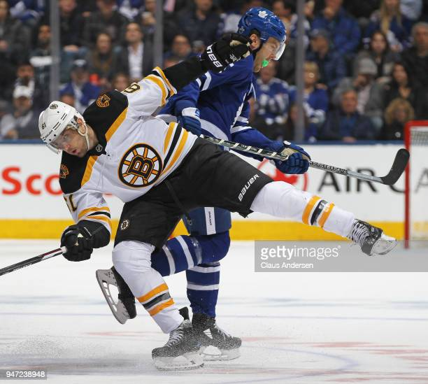 Rick Nash of the Boston Bruins is bumped by James van Riemsdyk of the Toronto Maple Leafs in Game Three of the Eastern Conference First Round during...