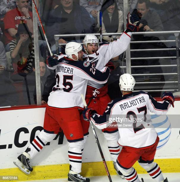 Rick Nash of the Columbus Blue Jackets celebrates his game-tying goal in the third period against the Chicago Blackhawks with teammates Jason Chimera...