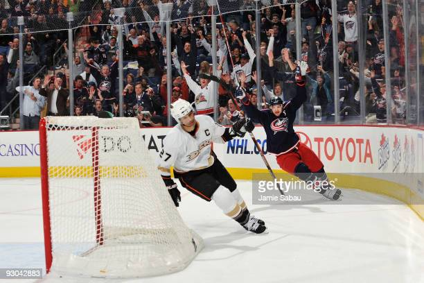 Rick Nash of the Columbus Blue Jackets celebrates his goal against the Anaheim Ducks late in the fist period as Scott Niedermayer skates by on...