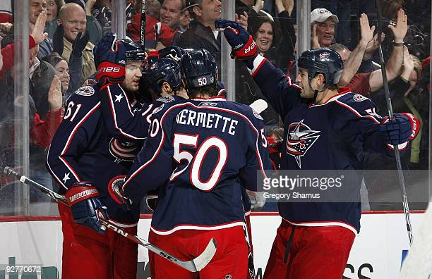 Rick Nash of the Columbus Blue Jackets celebrates his secondperiod goal with Antoine Vermette and Fedor Tyutin while playing the San Jose Sharks on...