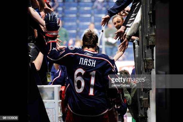 Rick Nash of the Columbus Blue Jackets high fives fans on his way out to the ice for the warmup prior to the start of the game against the the Tampa...