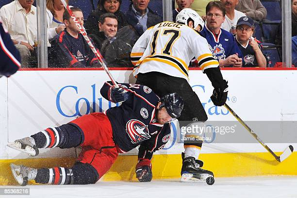 Rick Nash of the Columbus Blue Jackets looses his footing while attempting to finish a check on Milan Lucic of the Boston Bruins on March 10, 2009 at...