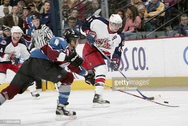 Rick Nash of the Columbus Blue Jackets shoots on goal during the game against the Colorado Avalanche on January 7, 2006 at Pepsi Center in Denver,...