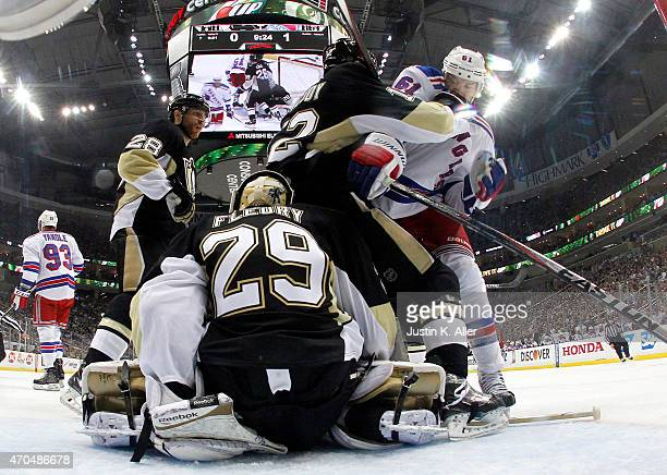 Rick Nash of the New York Rangers battles in front with Ben Lovejoy and MarcAndre Fleury of the Pittsburgh Penguins in Game Three of the Eastern...