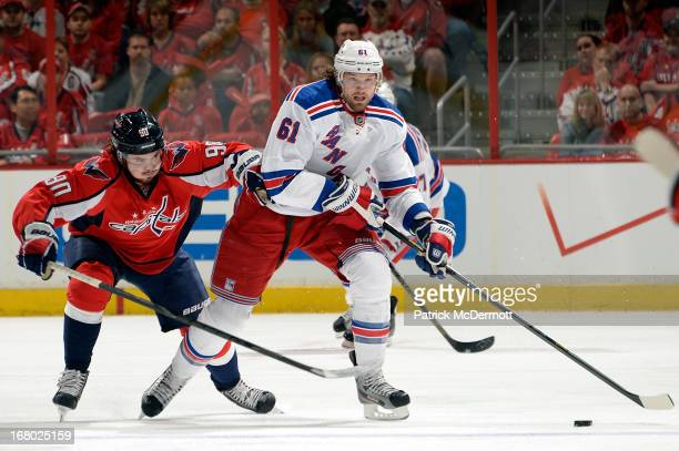 Rick Nash of the New York Rangers brings the puck up ice against Marcus Johansson of the Washington Capitals in the first period of Game Two of the...
