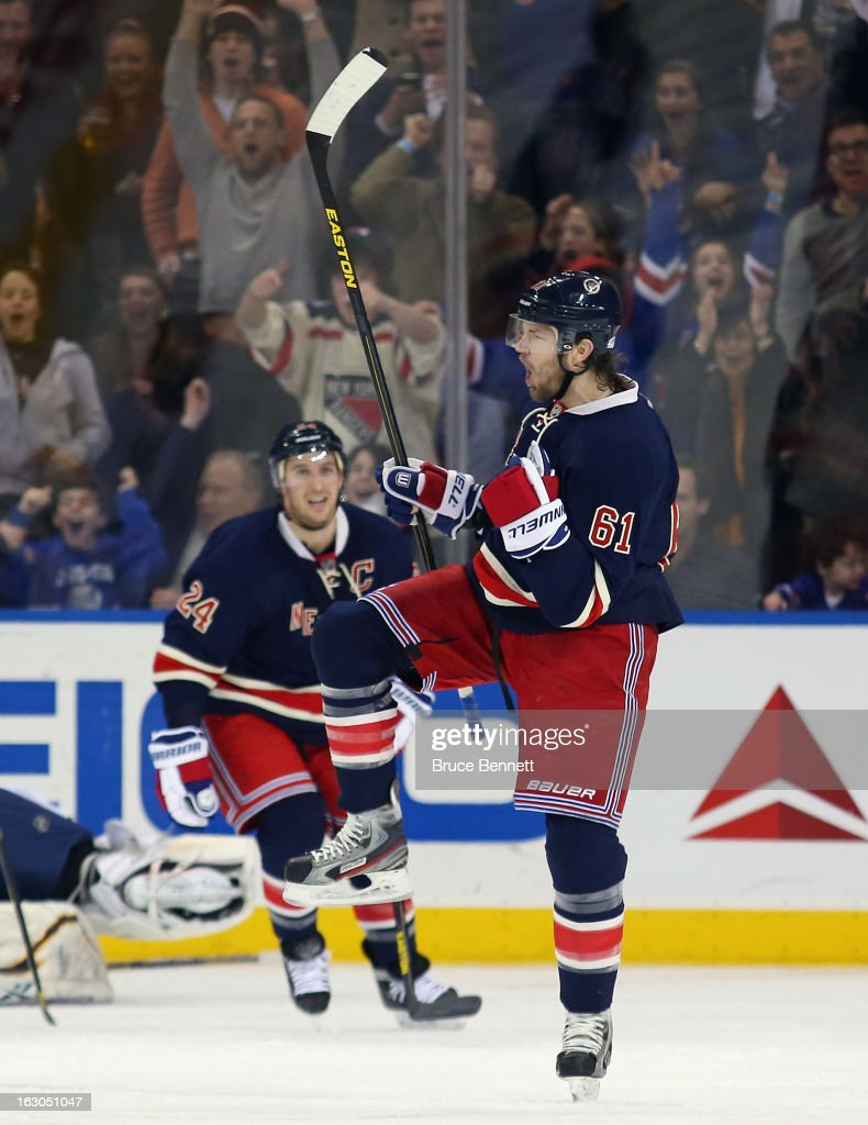 Rick Nash #61 of the New York Rangers celebrates his powerplay goal 4:18 of the third period against the Buffalo Sabres at Madison Square Garden on March 3, 2013 in New York City. The Rangers defeated the Sabres 3-2 in the shootout.