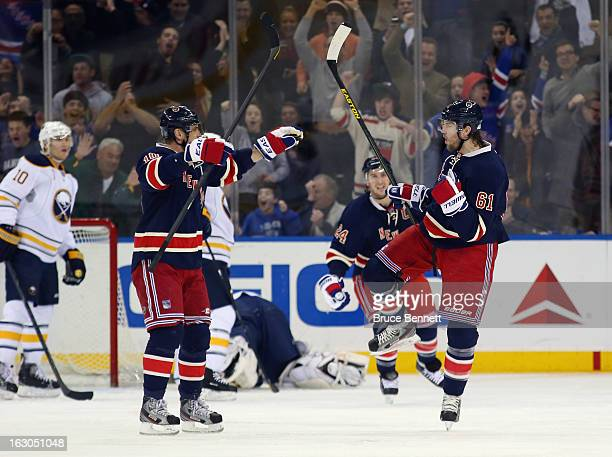Rick Nash of the New York Rangers celebrates his powerplay goal 418 of the third period against the Buffalo Sabres and is joined by Marian Gaborik at...