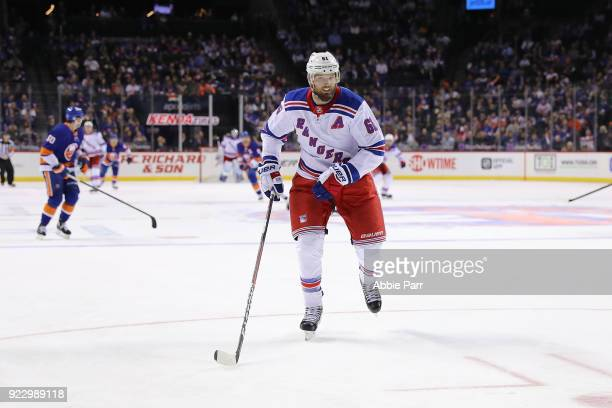 Rick Nash of the New York Rangers chases the puck in the third period against the New York Islanders during their game at Barclays Center on February...