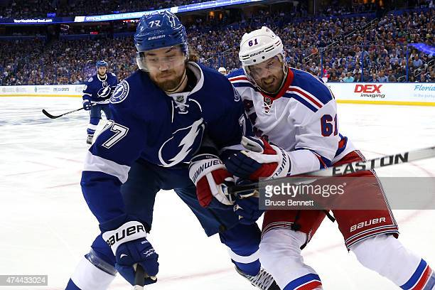 Rick Nash of the New York Rangers checks Victor Hedman of the Tampa Bay Lightning during the first period in Game Four of the Eastern Conference...