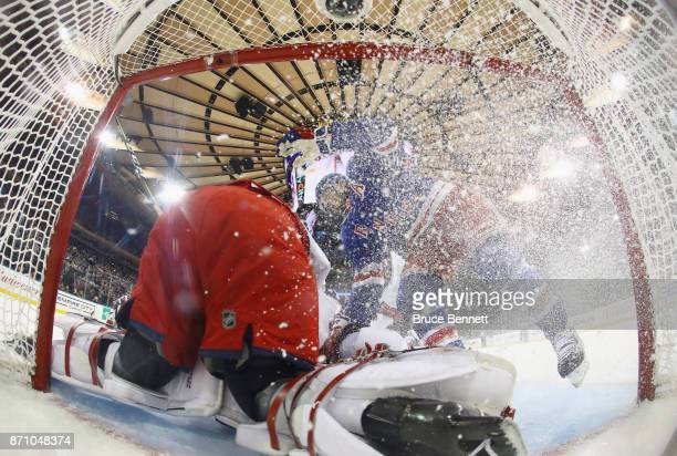 Rick Nash of the New York Rangers crashes into Sergei Bobrovsky of the Columbus Blue Jackets during the first period at Madison Square Garden on...
