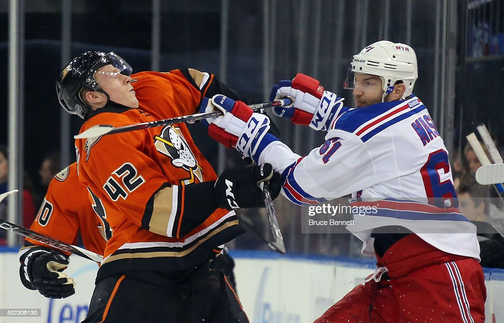 Rick Nash #61 of the New York Rangers gets the stick up on Josh Manson #42 of the Anaheim Ducks at Madison Square Garden on December 22, 2015 in New York City. The Rangers defeated the Ducks 3-2 in overtime.