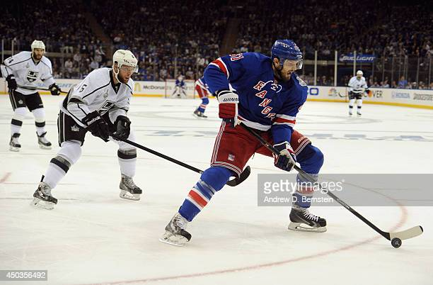 Rick Nash of the New York Rangers is chased by Jake Muzzin of the Los Angeles Kings during the second period of Game Three of the 2014 Stanley Cup...