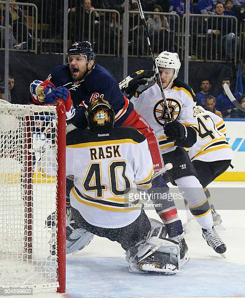 Rick Nash of the New York Rangers is pushed into Tuukka Rask by defenseman Kevan Miller of the Boston Bruins at Madison Square Garden on January 11...