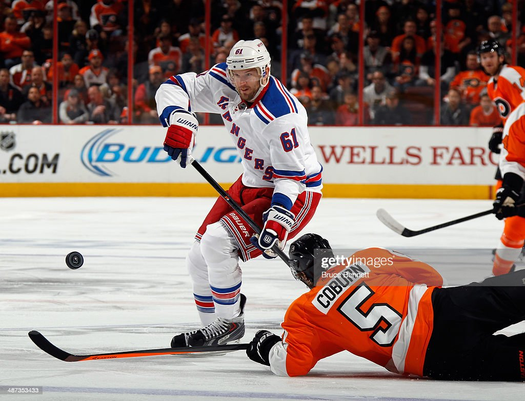 Rick Nash #61 of the New York Rangers moves the puck around Braydon Coburn #5 of the Philadelphia Flyers during the first period in Game Six of the First Round of the 2014 NHL Stanley Cup Playoffs at the Wells Fargo Center on April 29, 2014 in Philadelphia, Pennsylvania.